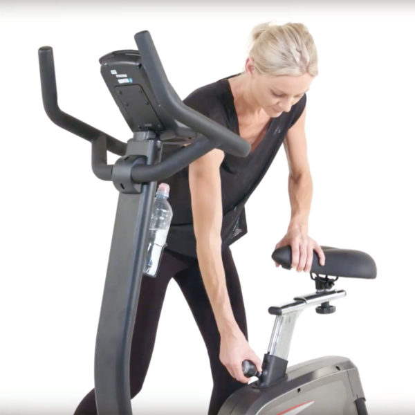 York Fitness LC-UB Upright Bike with model adjusting seat
